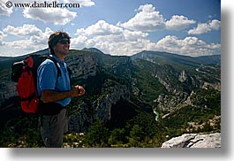 activities, backpack, clothes, clouds, colors, europe, france, groups, hiking, horizontal, men, mountains, nature, nicos, people, provence, red, scenics, sky, sunglasses, viewing, photograph