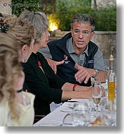 dinner, discussion, emotions, europe, foods, france, groups, men, people, provence, sergio, serious, tour guides, vertical, photograph