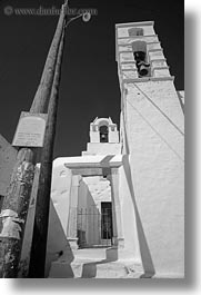 amorgos, bell towers, black and white, buildings, churches, europe, greece, lamp posts, structures, vertical, white wash, photograph