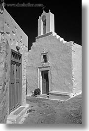 amorgos, bell towers, black and white, buildings, churches, doors, europe, greece, narrow, streets, structures, vertical, white, white wash, photograph