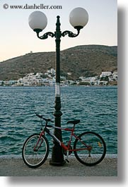 amorgos, bicycles, europe, greece, lamp posts, ocean, vertical, photograph