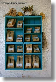 amorgos, bags, blues, browns, colors, europe, greece, shelves, spices, vertical, woods, photograph