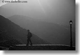 amorgos, black and white, europe, greece, horizontal, lamp posts, mountains, people, photographers, photograph