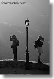 amorgos, black and white, europe, greece, lamp posts, people, photographers, vertical, photograph