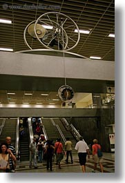 arts, athens, clocks, crowds, escalators, europe, greece, vertical, wheels, photograph