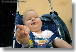 athens, babies, emotions, europe, fingers, greece, horizontal, people, pointing, smiles, stroller, photograph