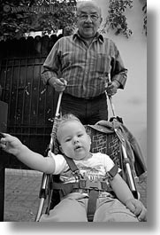 athens, babies, black and white, europe, grandfather, greece, people, stroller, vertical, photograph