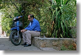 athens, blues, colors, emotions, europe, greece, green, horizontal, men, moped, people, sad, photograph