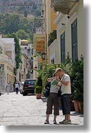 athens, europe, greece, looking, map, people, tourists, vertical, photograph