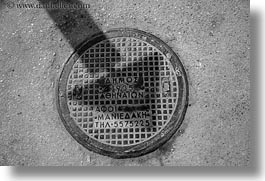 arrows, athens, black and white, covers, europe, greece, horizontal, manholes, shadows, streets, photograph