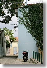 athens, buildings, covered, europe, greece, ivy, motorcycles, streets, vertical, photograph