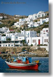 blues, boats, buildings, europe, greece, mykonos, red, structures, tops, vertical, photograph