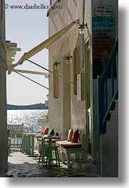 benches, buildings, colorful, europe, greece, mykonos, pillows, vertical, photograph