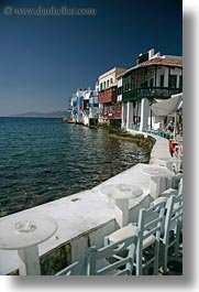 buildings, europe, greece, houses, mykonos, seaside, tables, vertical, waterfront, photograph