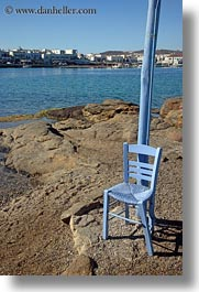blues, chairs, europe, greece, mykonos, poles, rocks, vertical, photograph