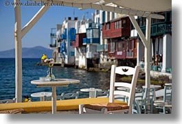 buildings, chairs, europe, flowers, greece, horizontal, mykonos, tables, waterfront, photograph