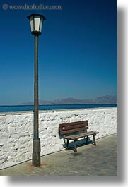 benches, chairs, europe, greece, lamp posts, mykonos, ocean, vertical, walls, white wash, photograph