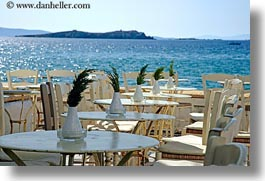 chairs, europe, greece, horizontal, mykonos, ocean, plants, tables, views, photograph