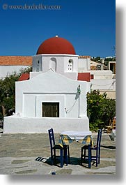 chairs, churches, domed, europe, greece, mykonos, red, tables, vertical, white wash, photograph