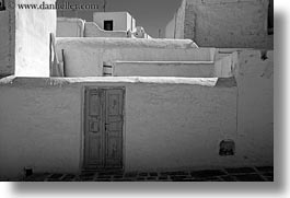 black and white, blues, doors, europe, greece, horizontal, mykonos, old, stucco, walls, white wash, photograph