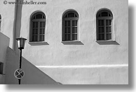 arches, black and white, europe, greece, horizontal, lamp posts, mykonos, threes, white wash, windows, photograph
