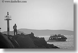 black and white, boats, europe, greece, horizontal, men, mykonos, rocks, watching, photograph