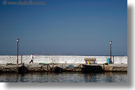 europe, greece, horizontal, men, mykonos, piers, stones, walking, photograph