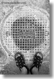 black and white, covers, europe, feet, greece, manholes, mykonos, vertical, white wash, photograph