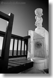 balconies, black and white, europe, greece, mykonos, statues, vertical, photograph
