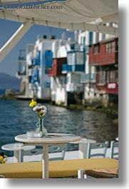 europe, flowers, greece, mykonos, tables, vertical, yellow, photograph