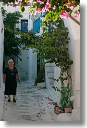 alleys, europe, greece, mykonos, old, people, vertical, walking, white wash, womens, photograph