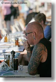 clothes, drinks, earrings, europe, glasses, greece, men, mykonos, people, tattoo, vertical, photograph