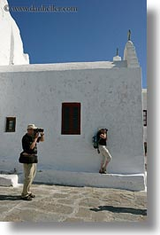 blues, cameras, colors, europe, greece, mykonos, people, photographers, two, vertical, white wash, photograph