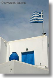 buildings, europe, flags, greece, greek, naxos, pots, stucco, vertical, white wash, photograph