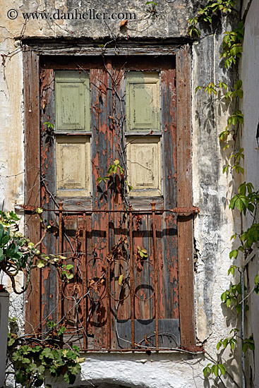 old wood door with rusted gate