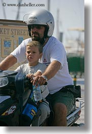boys, clothes, europe, fathers, glasses, greece, motorcycles, naxos, people, vertical, photograph