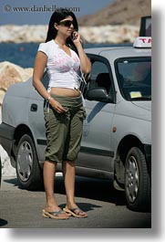 breasts, cell phone, clothes, europe, girls, greece, naxos, people, sunglasses, vertical, womens, photograph