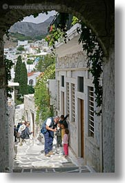 cameras, childrens, digital, europe, greece, men, naxos, people, showing, vertical, photograph