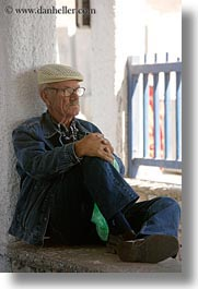 clothes, emotions, europe, glasses, greece, hats, men, naxos, old, people, serious, sitting, vertical, watching, photograph
