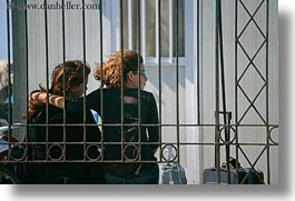 bars, behind, couples, europe, greece, hair, horizontal, irons, naxos, people, red, photograph