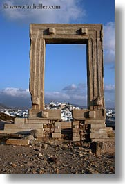 arches, architectural ruins, buildings, clouds, europe, greece, naxos, structures, temple of apollo, towns, vertical, photograph