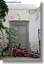 bicycles, colors, doors, europe, greece, naxos, red, vehicles, vertical, photograph
