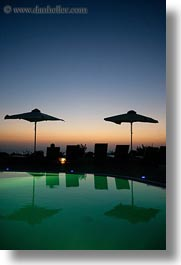 dusk, europe, greece, hotels, pools, santorini, sunsets, swimming pool, umbrellas, vertical, photograph