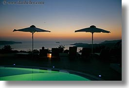 dusk, europe, greece, horizontal, hotels, pools, santorini, sunsets, swimming pool, umbrellas, photograph
