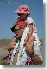 colors, emotions, europe, fathers, girls, greece, humor, pink, santorini, shoulders, vertical, photograph