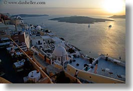 europe, greece, horizontal, nature, ocean, over, perched, santorini, scenics, sky, sun, sunsets, towns, photograph