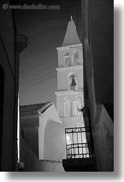 bell towers, black and white, buildings, churches, europe, greece, steeples, structures, tinos, vertical, white wash, photograph