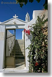 bell towers, bougainvilleas, buildings, churches, europe, gates, greece, red, structures, tinos, vertical, white wash, photograph