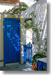 blues, doors, europe, greece, plants, shadowy, tinos, vertical, white wash, photograph