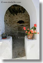 archways, europe, flowers, geraniums, greece, old, ruin, structures, tinos, vertical, white wash, photograph